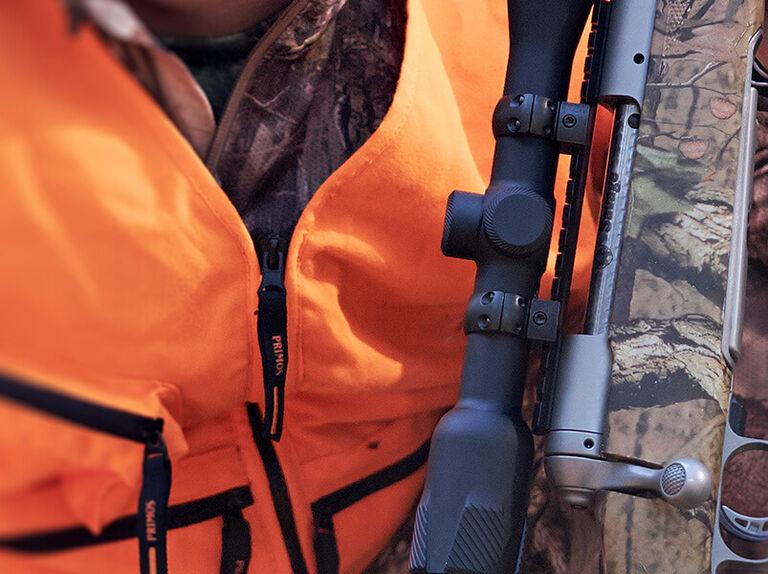 Hunter with rifle using Weaver mounts